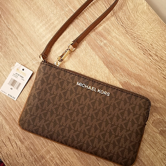 Michael Kors Handbags - BN Michael Kors Jet set travel wristlet